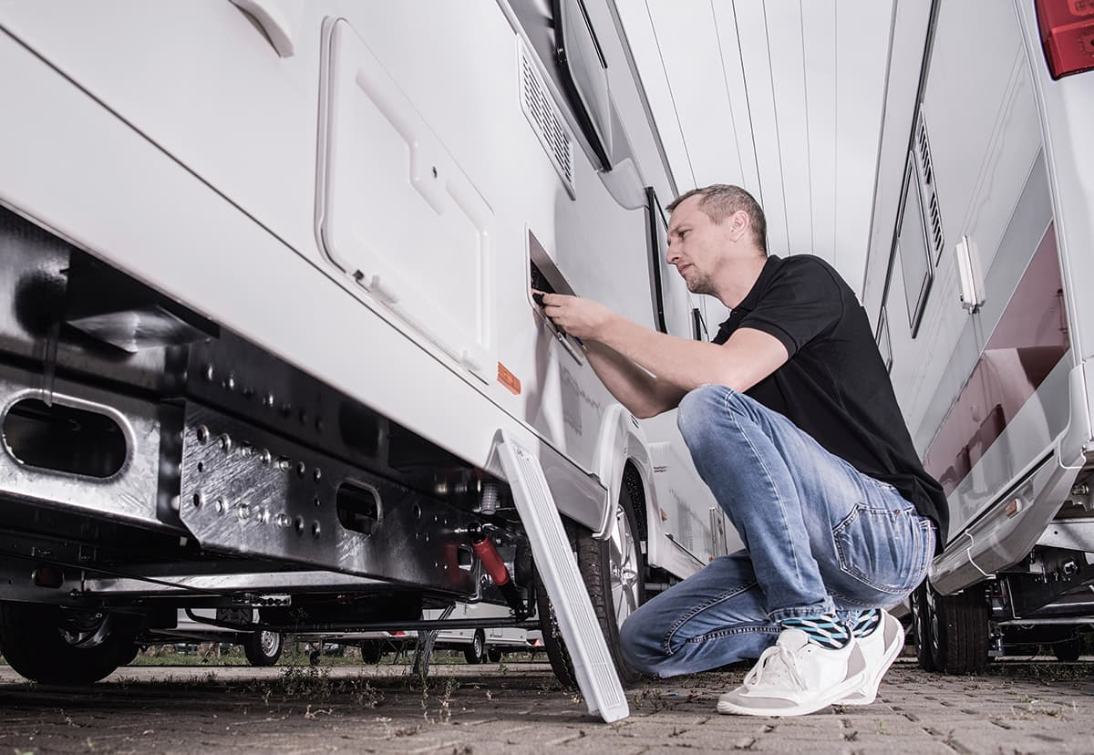 Man doing maintenance on his RV